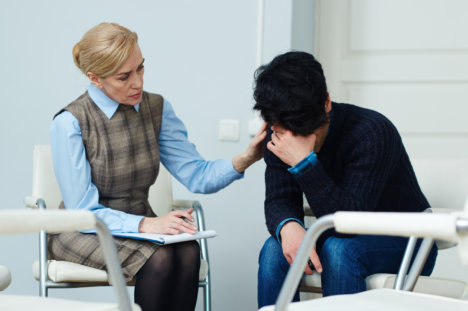 female expert counseling man
